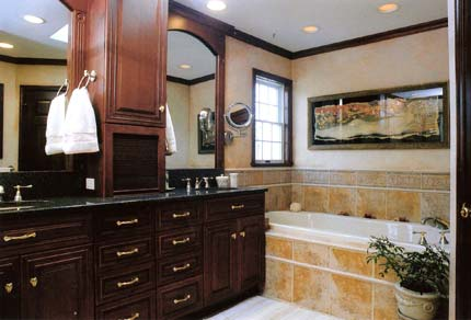 Bathroom with dark cabinetry and double vanity